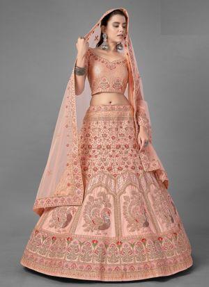 Indian Women Wear Satin Lehenga In Peach Color