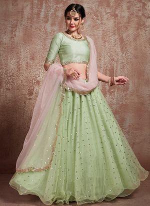 Most Demanded Pista Green Designer Lehenga Choli In Soft Net Fabric