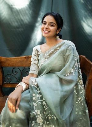 Engrossing Pistachio Green Embroidery Saree