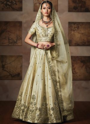Heavy Embroidery Cream Traditional Lehenga Choli For Diwali Celebration