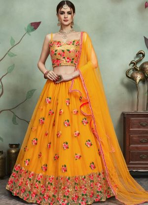 Most Demanded Mustard Designer Lehenga Choli In Soft Net Fabric