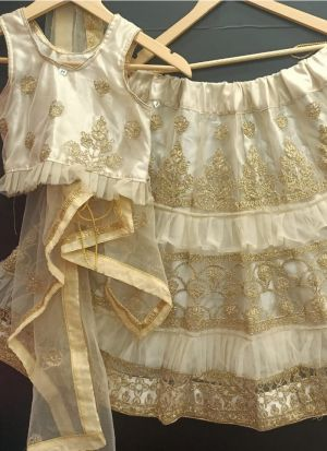 Party Wear Cream Net Embroidered Girls Lehenga Choli