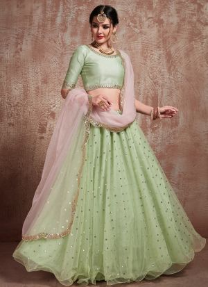 Most Demanded Pista Green Designer Lehenga Choli In Soft Net Fabric