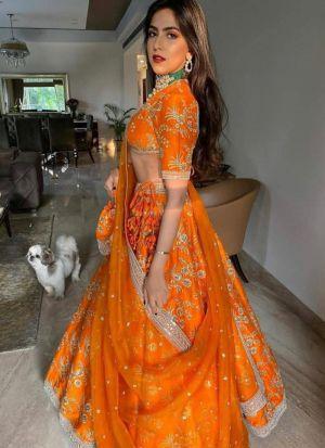 Demanding Orange Colour Sequence Work Lehenga Choli