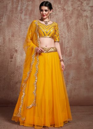 Most Demanded Mustard Color Designer Lehenga Choli In Soft Net Fabric
