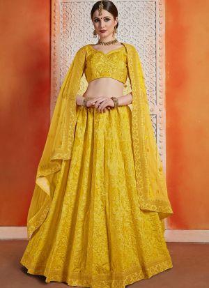 Most Popular Designs Of Yellow Designer Lehenga Choli With Soft Net Dupatta